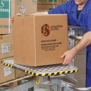 elevah 47 is a stock picking personnel access platform. The stock picker is seen here loading a box onto the handy shelf. The stock picker is wearing blue.